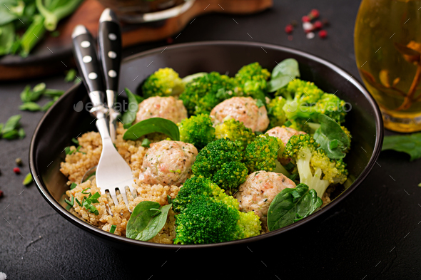 Baked meatballs of chicken fillet with garnish with quinoa and boiled broccoli - Stock Photo - Images