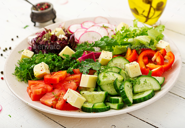 Mix salad from fresh vegetables and greens herbs. Dietary menu. Proper nutrition. Healthy lifestyle. - Stock Photo - Images