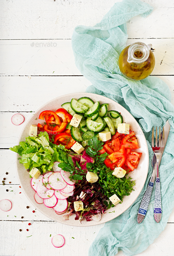 Mix salad from fresh vegetables and greens herbs - Stock Photo - Images