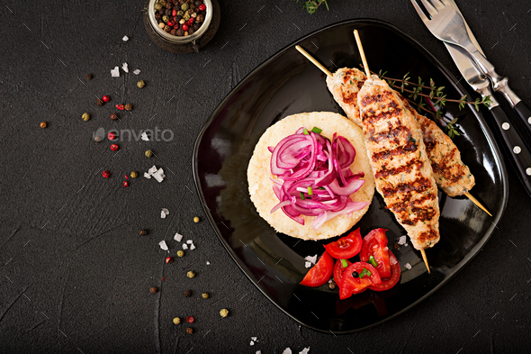 Minced Lula kebab grilled turkey (chicken) with fresh tomato and bulgur. Flat lay. Top iew - Stock Photo - Images