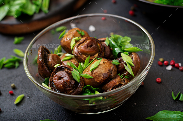 Baked mushrooms with soy sauce and herbs - Stock Photo - Images