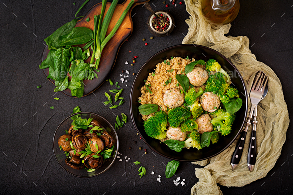 Baked meatballs of chicken fillet with garnish with quinoa and boiled broccoli. - Stock Photo - Images