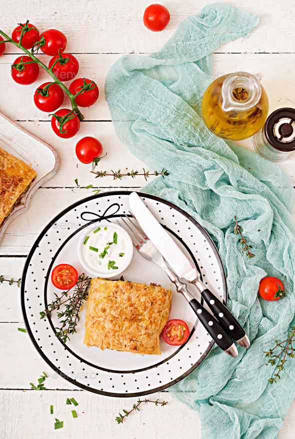 Appetizing strudel with minced beef, onions and herbs. Flat lay. Top view - Stock Photo - Images