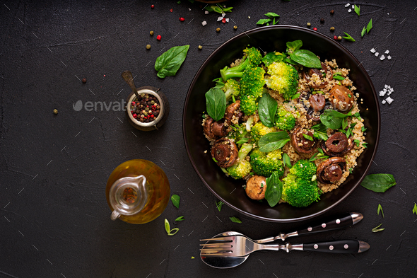 Healthy vegan salad of vegetables - broccoli, mushrooms, spinach and quinoa in a bowl. - Stock Photo - Images