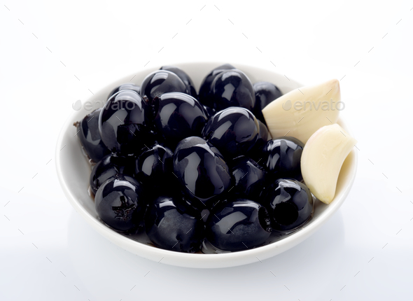 black olives in bowl isolated on white - Stock Photo - Images