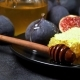 Figs with Honey on in the Plate on Dark Concrete Background - VideoHive Item for Sale