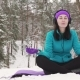 Smiling Girl Practicing Yoga in Winter