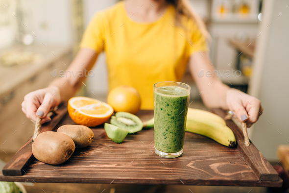 Female person with cocktail, fruits and vegetables - Stock Photo - Images