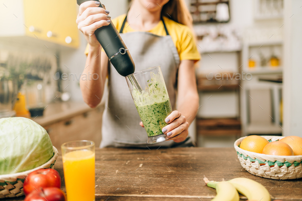 Female person cooking, mixing healthy organic food - Stock Photo - Images