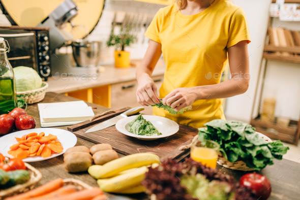 Housewife cooking on the kitchen, bio food - Stock Photo - Images