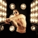 Sexy Man Dancing on the Background of Lights - VideoHive Item for Sale