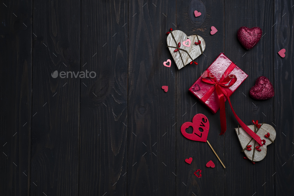 Gift box with red bow ribbon and wooden heart - Stock Photo - Images