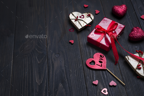 REd Holidays gift and heart on wooden background - Stock Photo - Images