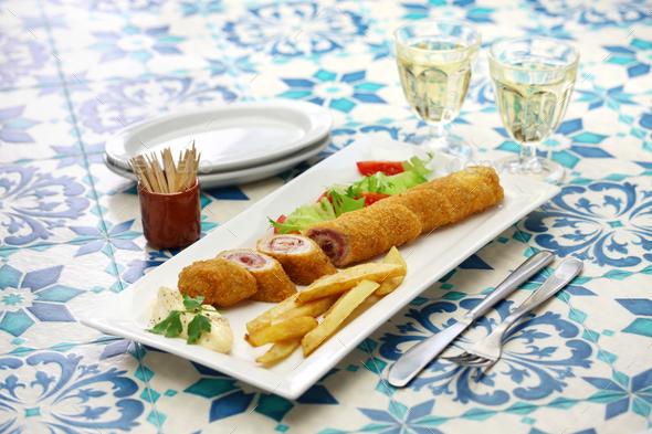 homemade flamenquin, spanish deep fried long pork roulade - Stock Photo - Images