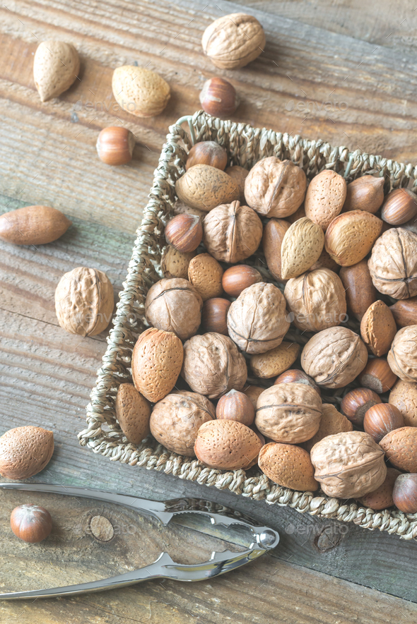 Assortment of nuts in the basket - Stock Photo - Images
