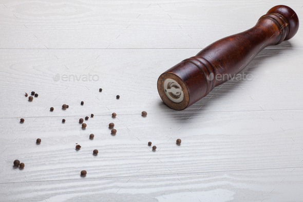 black pepper seeds and pepper mill - Stock Photo - Images