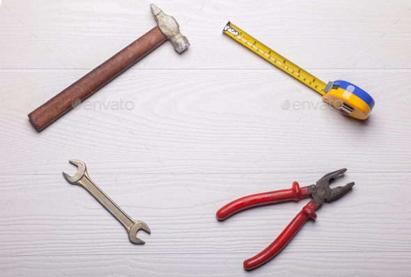 craft tools around empty area on white wooden table - Stock Photo - Images