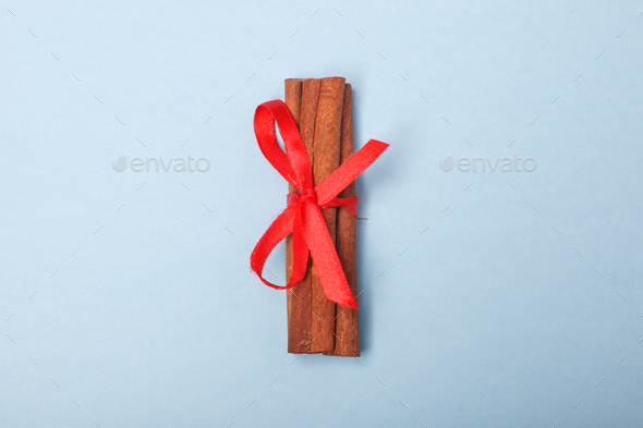 cinnamon bandaged with red ribbon - Stock Photo - Images