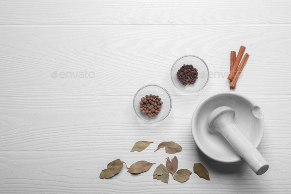 different spices near spice mortar - Stock Photo - Images