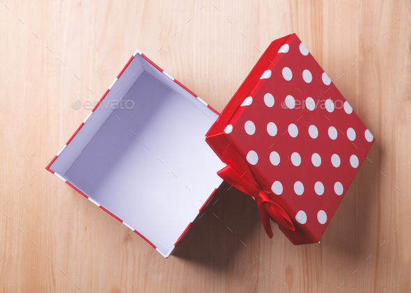 empty red gift box on wooden background - Stock Photo - Images