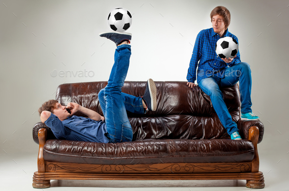 The two guys with balls on gray background - Stock Photo - Images