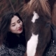 Pretty Woman Petting Horse in the Winter Forest - VideoHive Item for Sale