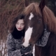 Asian Girl Petting Horse in the Winter Forest - VideoHive Item for Sale