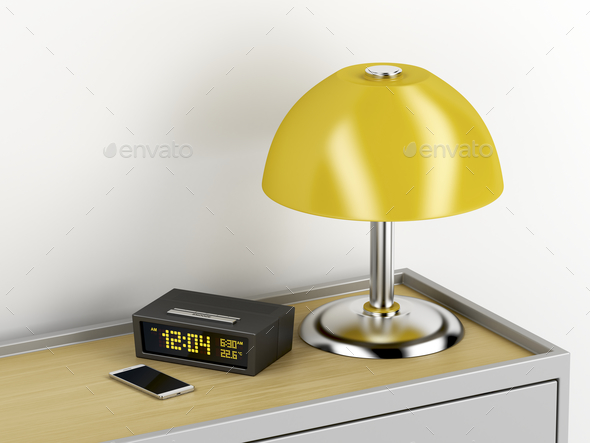 Nightstand with electric devices on it - Stock Photo - Images