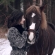 Young Woman Petting Horse in the Winter Forest - VideoHive Item for Sale
