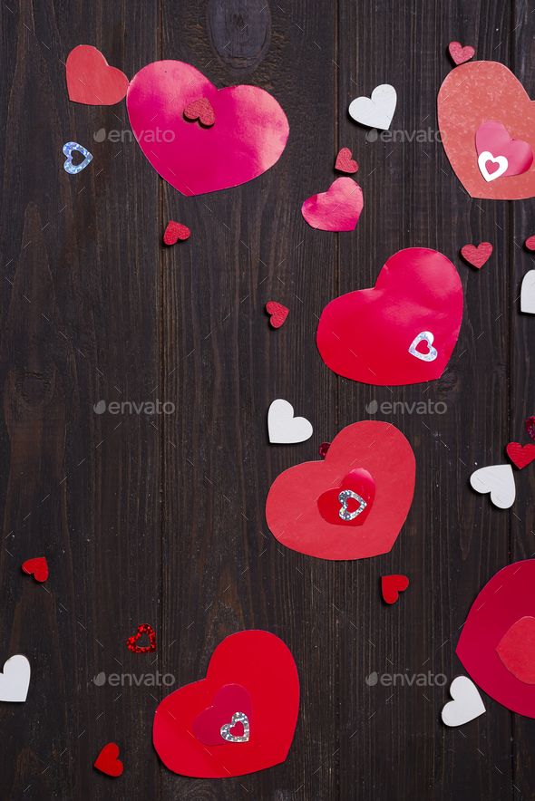 Red paper hearts on wooden background. - Stock Photo - Images