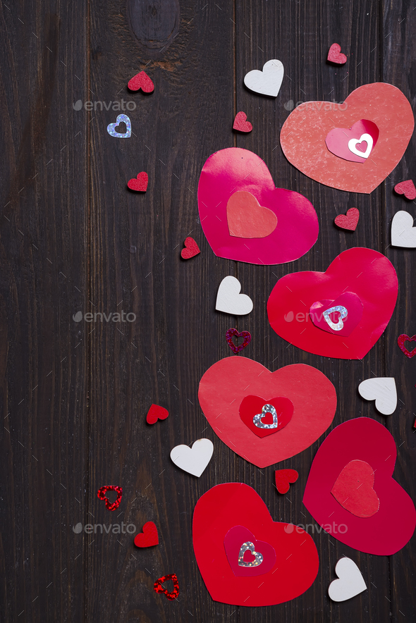 Border of Red paper hearts on wooden background. - Stock Photo - Images