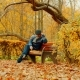 Old Man Is Playing Chess Alone on the Bench in the Autumn Park - VideoHive Item for Sale
