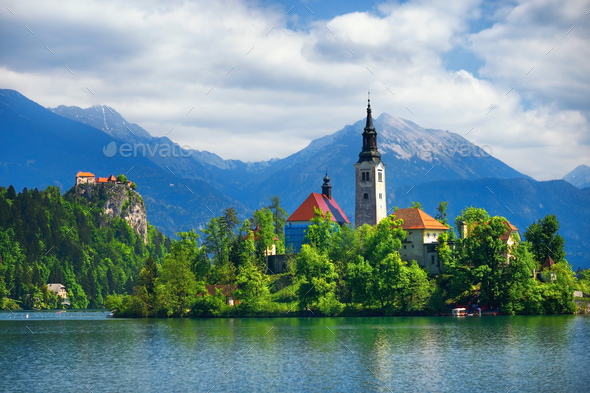 Bled Lake with church and mountains in background - Stock Photo - Images