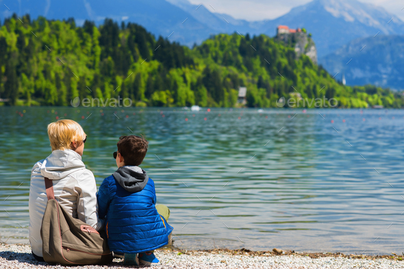 Mother and son resting by the lake - Stock Photo - Images