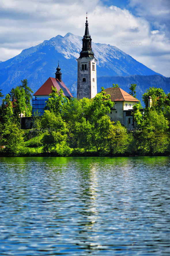 Bled Lake with Castle and Mountains in Background - Stock Photo - Images