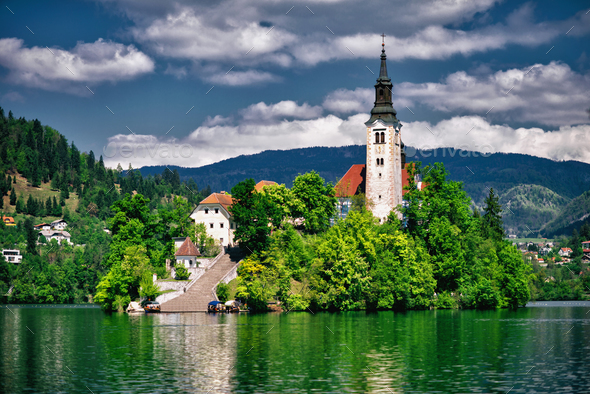 Bled lake with church island and mountains in background. - Stock Photo - Images