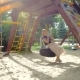 Video of Happy Smiling Young Woman Having Fun on Playground at Park - VideoHive Item for Sale