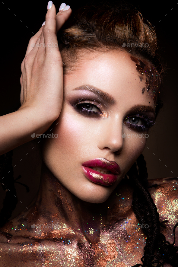 Fashion model with bright makeup and colorful glitter - Stock Photo - Images