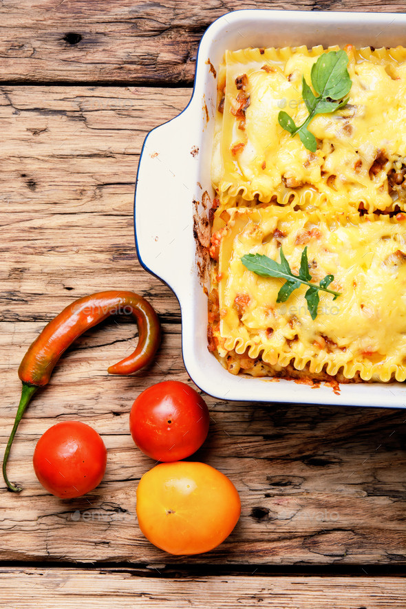 Homemade lasagna on wooden table - Stock Photo - Images