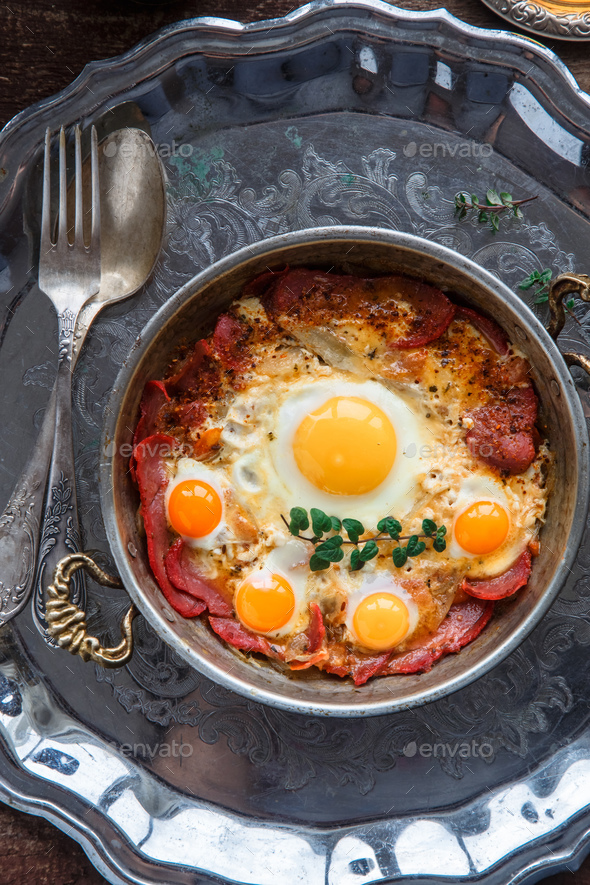 Top view of fried eggs with cured meat, turkish breakfast pastirmali yumurta - Stock Photo - Images