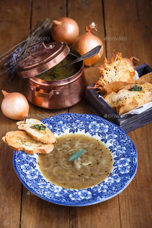Onion soup with cheese crouton in a plate - Stock Photo - Images