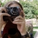 Footage of Young Woman Making Photo on Old Manual Camera at Park - VideoHive Item for Sale