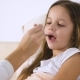Mother or Doctor Giving Medicine Syrup To Her Sick Daughter in Bed - VideoHive Item for Sale