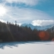 Horizontal Panorama of Lake in Mountains with Snow, Sun Flare and Blue Sky - VideoHive Item for Sale