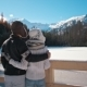 Young Couple Is Standing Near Mountain Lake in Winter Admiring Landskape - VideoHive Item for Sale