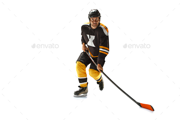 one caucasian man hockey player in studio silhouette isolated on white background - Stock Photo - Images