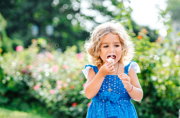 little girl eating ice cream - Stock Photo - Images