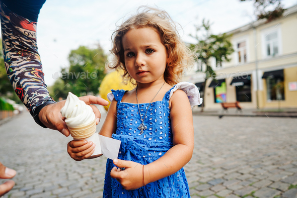 Beautiful little girl holds ice cream - Stock Photo - Images