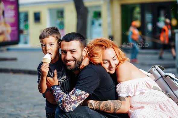 beautiful young family with ice cream - Stock Photo - Images