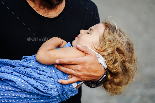 Cute little girl's sleeping in her father's arm - Stock Photo - Images